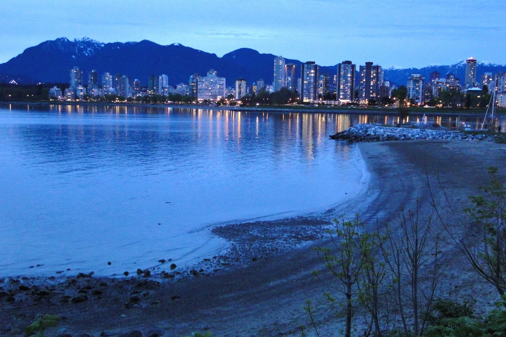 Dusk_View_of_Downtown_and_West_End_from_Kitsilano_Beach_-_Vancouver_BC_-_Canada